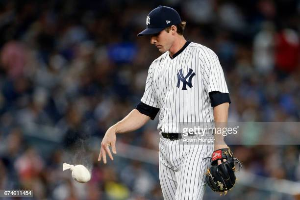 Bryan Mitchell of the New York Yankees throws down a rosin bag after giving up a grand slam home run to Mark Trumbo of the Baltimore Orioles during...