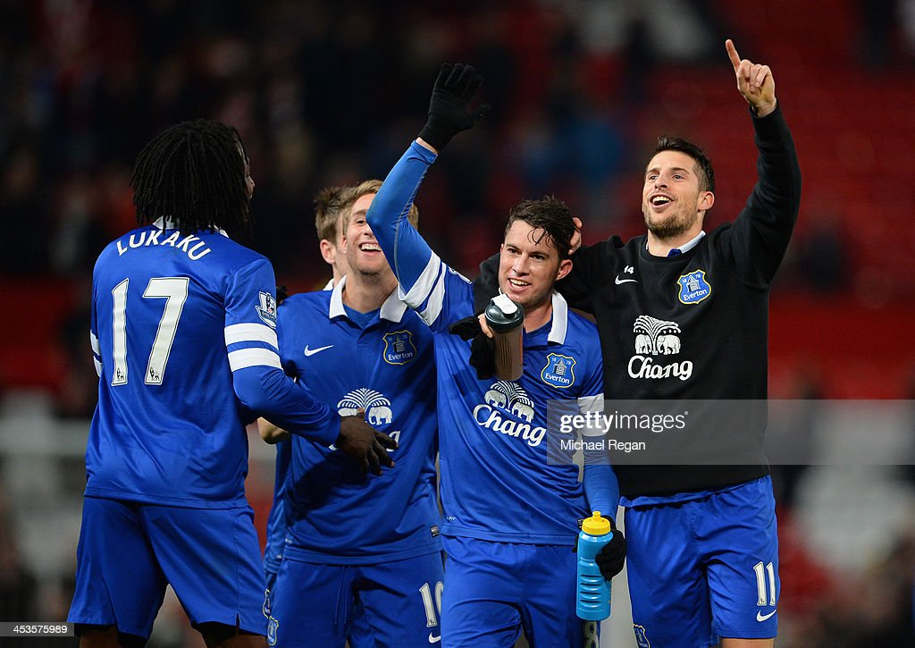 Bryan Oviedo of Everton (2nd on R) celebrates with his team-mates at the end of the Barclays Premier League match between Manchester United and Everton at Old Trafford on December 4, 2013 in Manchester, England.