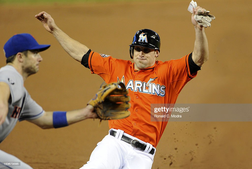 Bryan Petersen #11 of the Miami Marlins slides into third base during a MLB game against the New York Mets at Marlins Park on October 3, 2012 in Miami, Florida.