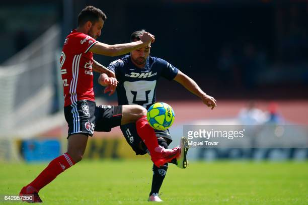 Bryan Rabello of Pumas fights for the ball with Jorge Ortiz of Xolos during the 7th round match between Pumas UNAM and Tijuana as part of the Torneo...