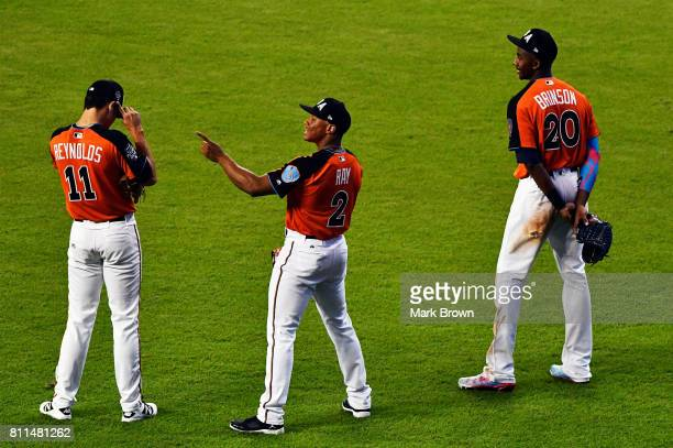 Bryan Reynolds of the San Francisco Giants Corey Ray of the Milwaukee Brewers and Lewis Brinson of the Milwaukee Brewers and the US Team look on...