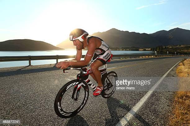 Bryan Rhodes of Christchurch rides along the Lake Wanaka waterfront during Challenge Wanaka on January 18 2014 in Wanaka New Zealand