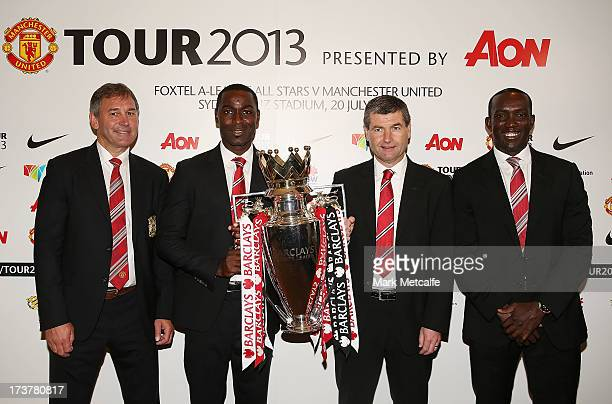 Bryan Robson Andy Cole Dennis Irwin and Dwight Yorke pose with the Barclays Premier League trophy during the official Manchester United official...