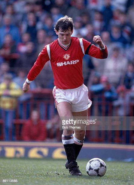 Bryan Robson in action for Manchester United against Sheffield Wednesday at Old Trafford 13th April 1986