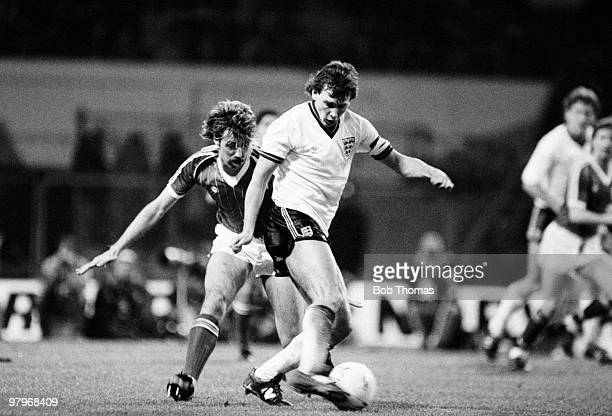 Bryan Robson of England is challenged by Mark Lawrenson of the Republic of Ireland during the England v Republic of Ireland Friendly International...