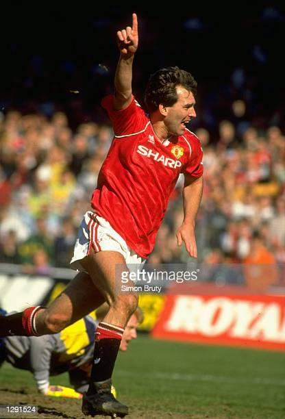 Bryan Robson of Manchester United celebrates after scoring the first goal during the FA Cup SemiFinal against Oldham at Maine Road in Manchester...