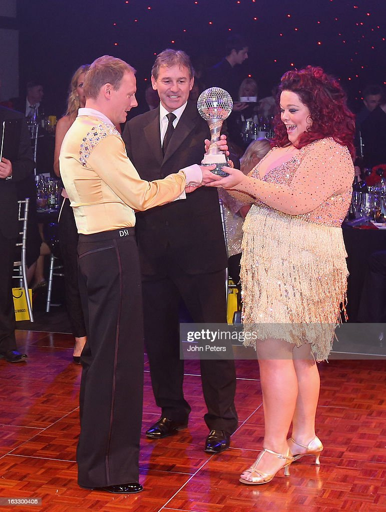 Bryan Robson of Manchester United presents winners Antony Cotton and Lisa Riley with the winners' trophy as part of Dancing with United, in aid of the Manchester United Foundation, at Old Trafford on March 7, 2013 in Manchester, England.