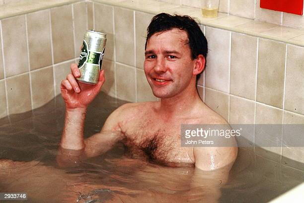 Bryan Robson relaxes in the dressing room after winning the FA Carling Premiership following the Premiership Match between Manchester United v...