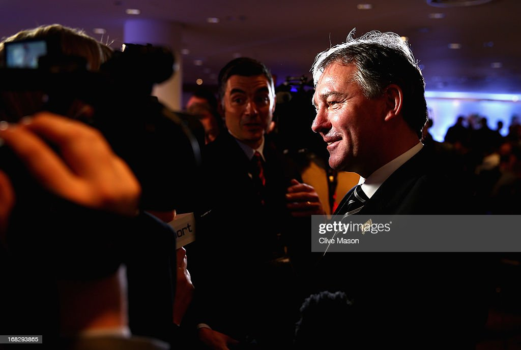 <a gi-track='captionPersonalityLinkClicked' href=/galleries/search?phrase=Bryan+Robson&family=editorial&specificpeople=206232 ng-click='$event.stopPropagation()'>Bryan Robson</a> talks to the media during the Football Association's Royal Mail Stamp Launch at Wembley Stadium on May 8, 2013 in London, England.