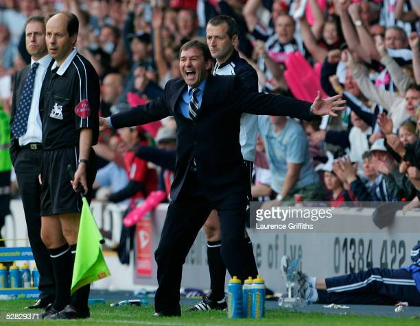 Bryan Robson the WBA manager celebrates his team scoring a second goal during the Barclays Premiership match between West Bromwich Albion and...