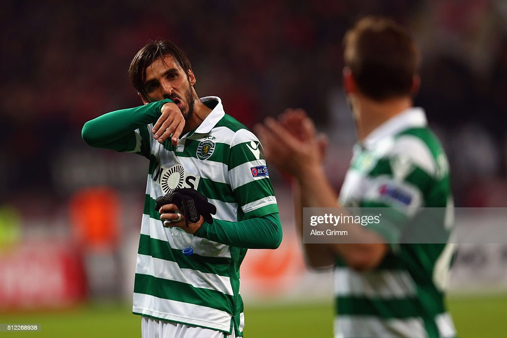 Bryan Ruiz and Joao Pereira of Sporting react after the UEFA Europa League round of 32 second leg match between Bayer Leverkusen and Sporting Lisbon...