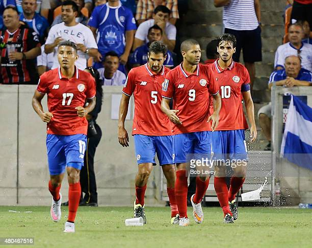 Bryan Ruiz of Costa Rica avoids a drink thrown by El Salvador fans after he scored in the second half as Alvaro Saborio Celso Borges and Johan...