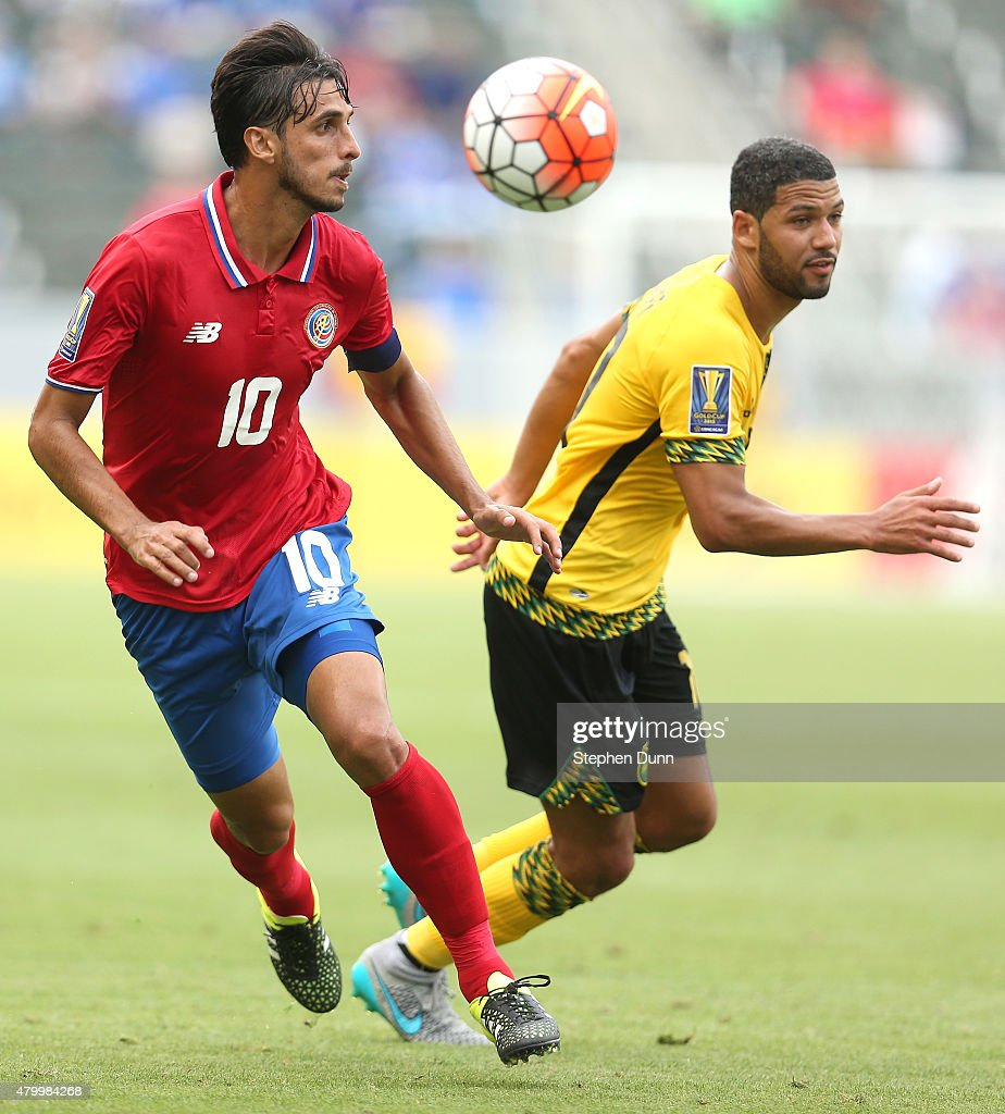 <a gi-track='captionPersonalityLinkClicked' href=/galleries/search?phrase=Bryan+Ruiz&family=editorial&specificpeople=714489 ng-click='$event.stopPropagation()'>Bryan Ruiz</a> #10 of Costa Rica chases the ball against Joel McAnuff #10 of Jamaica in their CONCACAF Gold Cup Group B match at StubHub Center on July 8, 2015 in Los Angeles, California.