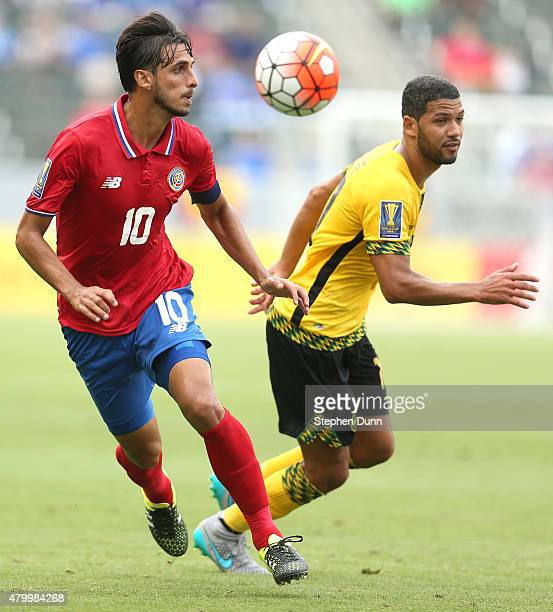 Bryan Ruiz of Costa Rica chases the ball against Joel McAnuff of Jamaica in their CONCACAF Gold Cup Group B match at StubHub Center on July 8 2015 in...