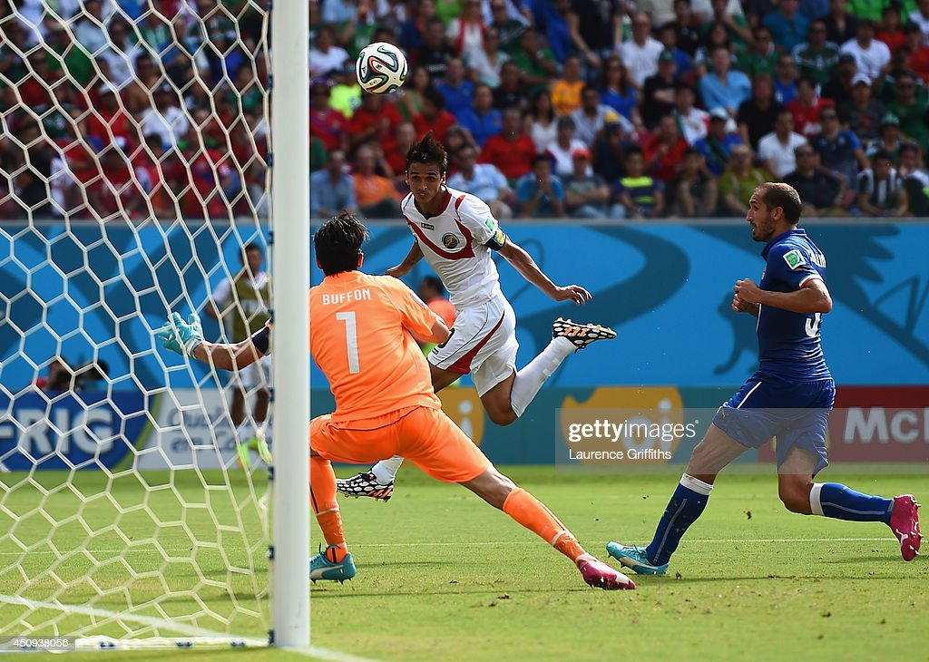 <a gi-track='captionPersonalityLinkClicked' href=/galleries/search?phrase=Bryan+Ruiz&family=editorial&specificpeople=714489 ng-click='$event.stopPropagation()'>Bryan Ruiz</a> of Costa Rica scores his team's first goal past <a gi-track='captionPersonalityLinkClicked' href=/galleries/search?phrase=Gianluigi+Buffon&family=editorial&specificpeople=208860 ng-click='$event.stopPropagation()'>Gianluigi Buffon</a> of Italy during the 2014 FIFA World Cup Brazil Group D match between Italy and Costa Rica at Arena Pernambuco on June 20, 2014 in Recife, Brazil.