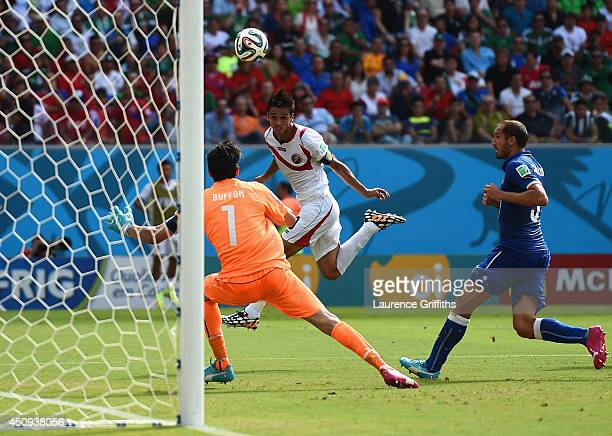 Bryan Ruiz of Costa Rica scores his team's first goal past Gianluigi Buffon of Italy during the 2014 FIFA World Cup Brazil Group D match between...