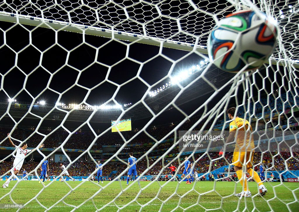 Bryan Ruiz of Costa Rica scores his team's first goal past Orestis Karnezis of Greece during the 2014 FIFA World Cup Brazil Round of 16 match between...