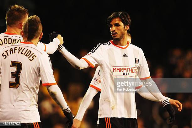 Bryan Ruiz of Fulham celebrates with team mate Cauley Woodrow after scoring the winning goal during the Sky Bet Championship match between Fulham and...