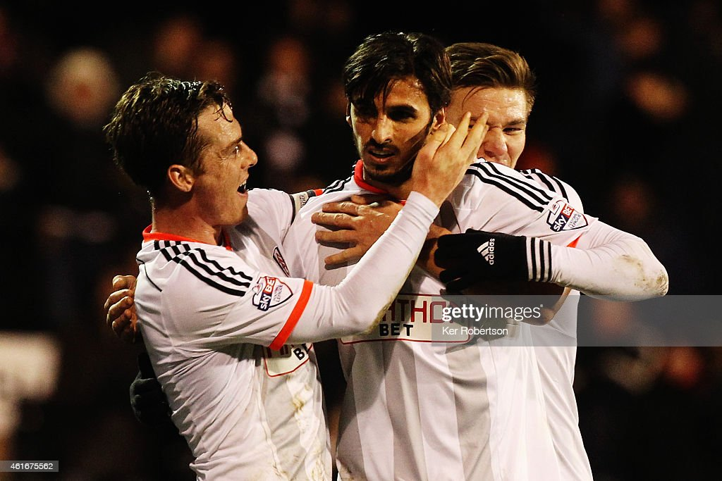 Bryan Ruiz of Fulham celebrates with team mate Scott Parker after scoring the winning goal during the Sky Bet Championship match between Fulham and...