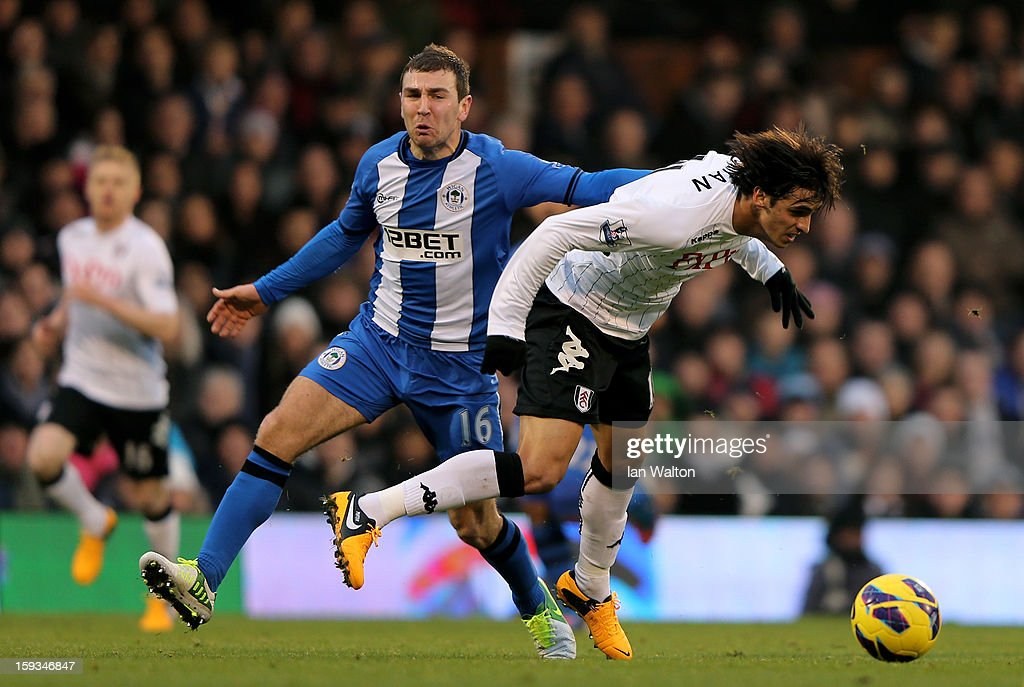 <a gi-track='captionPersonalityLinkClicked' href=/galleries/search?phrase=Bryan+Ruiz&family=editorial&specificpeople=714489 ng-click='$event.stopPropagation()'>Bryan Ruiz</a> of Fulham is challenged by James McArthur of Wigan during the Barclays Premier League match between Fulham and Wigan Athletic at Craven Cottage on January 12, 2013 in London, England.