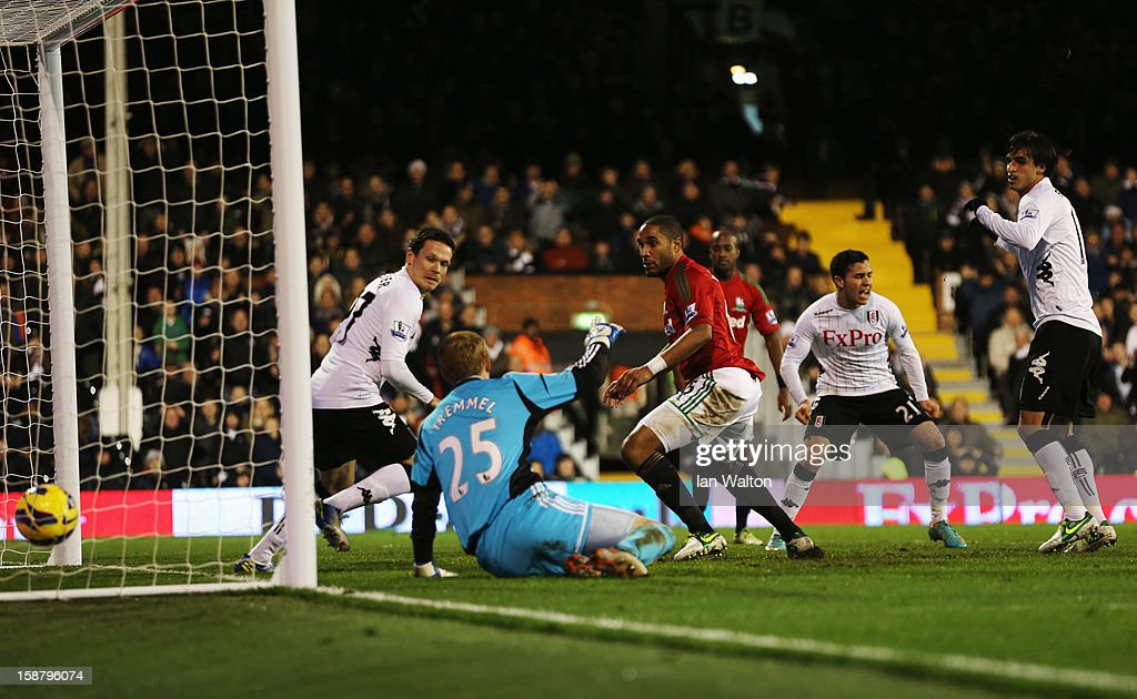 Bryan Ruiz (R) of Fulham scores during the Barclays Premier League match between Fulham and Swansea City at Craven Cottage on December 29, 2012 in London, England.