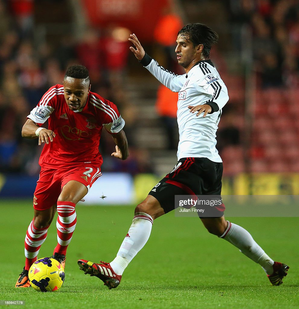 Bryan Ruiz of Fulham tackles Nathaniel Clyne of Southampton during the Barclays Premier League match between Southampton and Fulham at St Mary's Stadium on October 26, 2013 in Southampton, England.