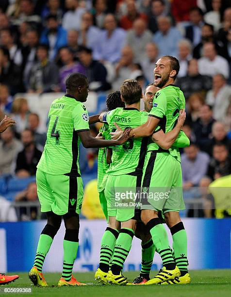 Bryan Ruiz of Sporting Clube de Portugal celebrates after Bruno Cesar scored his team's opening goal during the UEFA Champions League Group F match...