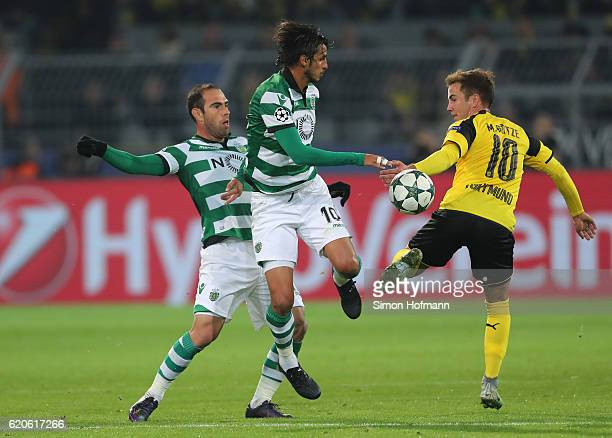 Bryan Ruiz of Sporting CP and Mario Goetze of Borussia Dortmund battle for possession during the UEFA Champions League Group F match between Borussia...