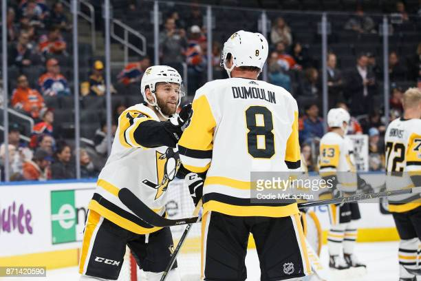 Bryan Rust and Brian Dumoulin of the Pittsburgh Penguins rough house during warm up before the game against the Edmonton Oilers at Rogers Place on...