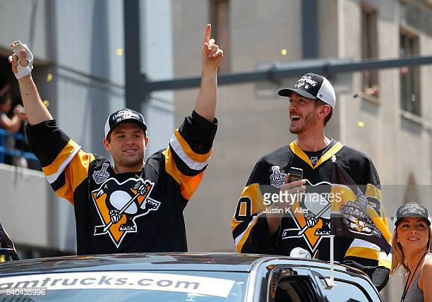 Bryan Rust and Matt Murray of the Pittsburgh Penguins celebrate during the Victory Parade and Rally on June 15 2016 in Pittsburgh Pennsylvania The...