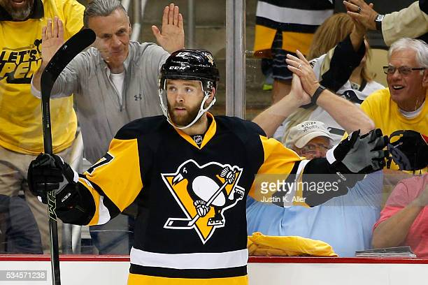 Bryan Rust of the Pittsburgh Penguins celebrates after scoring a goal against Andrei Vasilevskiy of the Tampa Bay Lightning during the second period...
