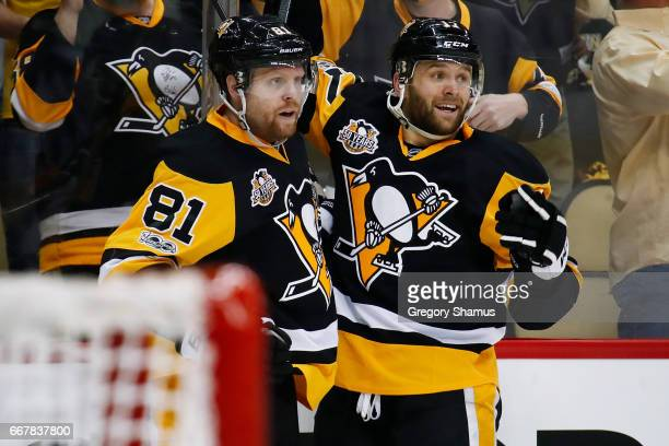 Bryan Rust of the Pittsburgh Penguins celebrates his second period goal with Phil Kessel while playing the Columbus Blue Jackets in Game One of the...