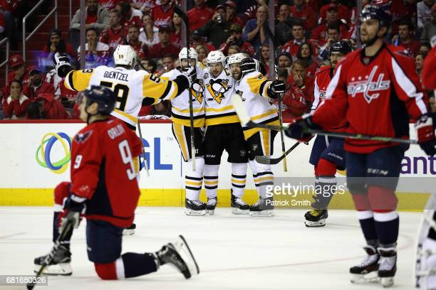 Bryan Rust of the Pittsburgh Penguins celebrates scoring a second period goal with teammates Sidney Crosby Ian Cole and Jake Guentzel against the...