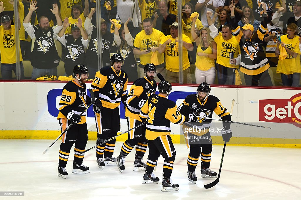 Bryan Rust #17 of the Pittsburgh Penguins celebrates with <a gi-track='captionPersonalityLinkClicked' href=/galleries/search?phrase=Chris+Kunitz&family=editorial&specificpeople=604159 ng-click='$event.stopPropagation()'>Chris Kunitz</a> #14, <a gi-track='captionPersonalityLinkClicked' href=/galleries/search?phrase=Justin+Schultz&family=editorial&specificpeople=5370958 ng-click='$event.stopPropagation()'>Justin Schultz</a> #4, <a gi-track='captionPersonalityLinkClicked' href=/galleries/search?phrase=Evgeni+Malkin&family=editorial&specificpeople=221676 ng-click='$event.stopPropagation()'>Evgeni Malkin</a> #71, and <a gi-track='captionPersonalityLinkClicked' href=/galleries/search?phrase=Ian+Cole&family=editorial&specificpeople=4361308 ng-click='$event.stopPropagation()'>Ian Cole</a> #28 after scoring a first period goal against the San Jose Sharks in Game One of the 2016 NHL Stanley Cup Final at Consol Energy Center on May 30, 2016 in Pittsburgh, Pennsylvania.