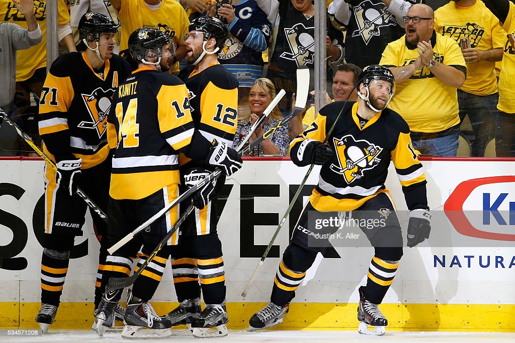 Bryan Rust #17 of the Pittsburgh Penguins celebrates with his teammates after scoring a goal against Andrei Vasilevskiy #88 of the Tampa Bay Lightning during the second period in Game Seven of the Eastern Conference Final during the 2016 NHL Stanley Cup Playoffs at Consol Energy Center on May 26, 2016 in Pittsburgh, Pennsylvania.