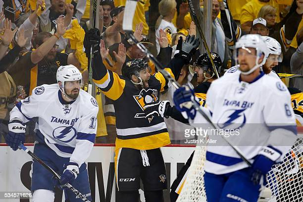 Bryan Rust of the Pittsburgh Penguins celebrates with his teammates after scoring a goal against Andrei Vasilevskiy of the Tampa Bay Lightning during...