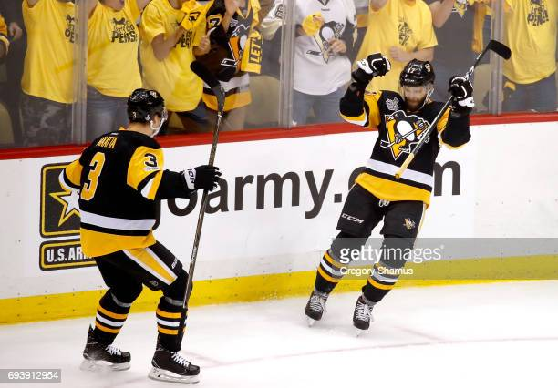 Bryan Rust of the Pittsburgh Penguins celebrates with Olli Maatta after scoring his team's second goal in the first period against the Nashville...