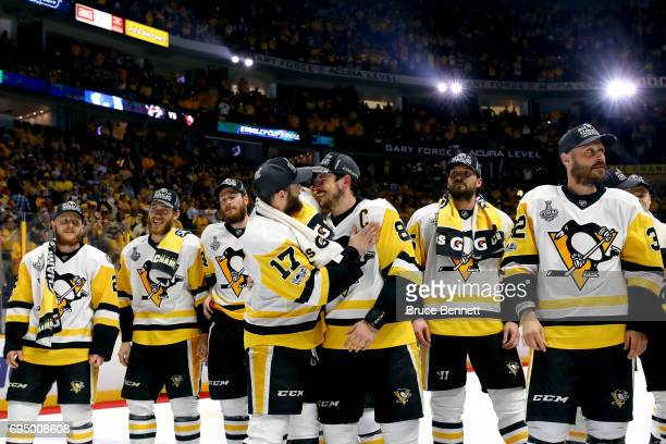 Bryan Rust of the Pittsburgh Penguins celebrates with Sidney Crosby after they defeated the Nashville Predators 20 in Game Six of the 2017 NHL...