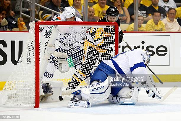 Bryan Rust of the Pittsburgh Penguins scores a goal against Andrei Vasilevskiy of the Tampa Bay Lightning during the second period in Game Seven of...