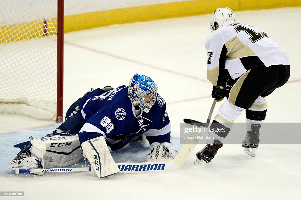 Bryan Rust #17 of the Pittsburgh Penguins scores a goal on Andrei Vasilevskiy #88 of the Tampa Bay Lightning during the third period in Game Six of the Eastern Conference Final during the 2016 NHL Stanley Cup Playoffs at Amalie Arena on May 24, 2016 in Tampa, Florida.