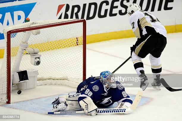Bryan Rust of the Pittsburgh Penguins scores a goal on Andrei Vasilevskiy of the Tampa Bay Lightning during the third period in Game Six of the...