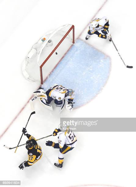 Bryan Rust of the Pittsburgh Penguins scores his team's second goal against Tristan Jarry of the Pittsburgh Penguins in the first period in Game Five...