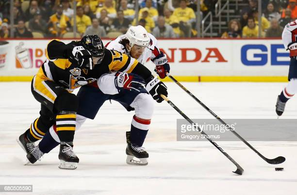 Bryan Rust of the Pittsburgh Penguins skates against TJ Oshie of the Washington Capitals in Game Six of the Eastern Conference Second Round during...