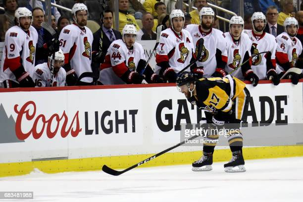 Bryan Rust of the Pittsburgh Penguins skates back to the bench after being hit by Dion Phaneuf of the Ottawa Senators during the first period in Game...