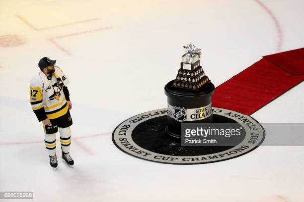Bryan Rust of the Pittsburgh Penguins skates past the Conn Smythe Trophy after his teams 20 victory over the Nashville Predators to wint the 2017...