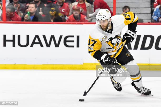 Bryan Rust of the Pittsburgh Penguins skates the puck against the Ottawa Senators in Game Six of the Eastern Conference Final during the 2017 NHL...
