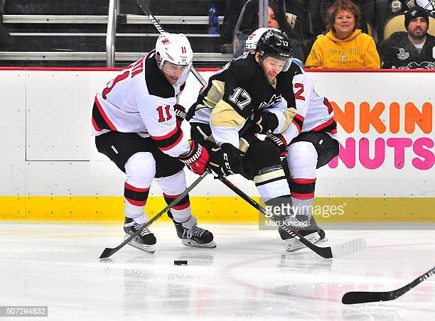 Bryan Rust of the Pittsburgh Penguins skates with the puck against the New Jersey Devils at Consol Energy Center on January 26 2016 in Pittsburgh...