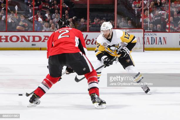 Bryan Rust of the Pittsburgh Penguins skates with the puck against Dion Phaneuf of the Ottawa Senators in Game Six of the Eastern Conference Final...