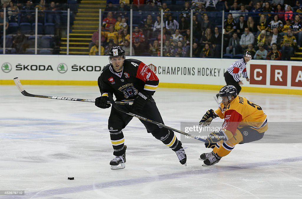 Bryan Schmidt #4 of Nottingham Panthers and Jesper Piitulainen #54 of Lukko Rauma contest possession during the Champions Hockey League group stage game at the National Ice Centre in Nottingham, between Nottingham Panthers and Lukko Rauma on August 22, 2014 in Nottingham, United Kingdom.