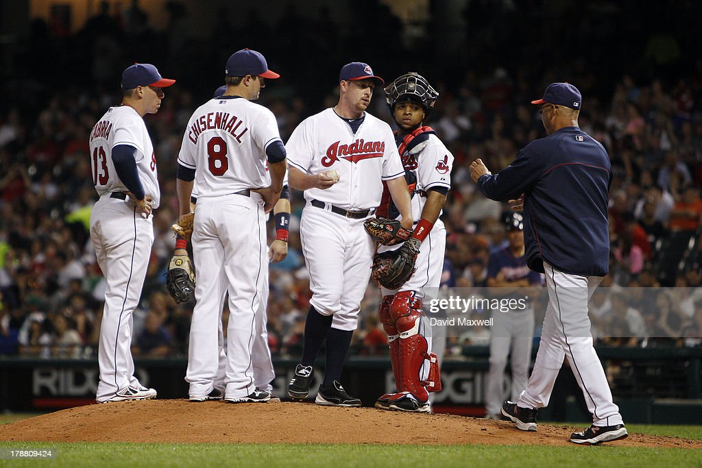 Bryan Shaw #27 of the Cleveland Indians is releived by manager Manager Terry Francona #17 as Asdrubal Cabrera #13, Lonnie Chisenhall #8, and Carlos Santana #41 meet at the mound against the Minnesota Twins during the seventh inning of their game on August 23, 2013 at Progressive Field in Cleveland, Ohio. The Twins defeated the Indians 5-1.